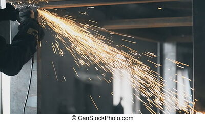 Industrial engineer working on cutting a metal and steel with compound Metal Angle Grinder Machine