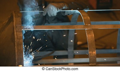 Welding Engineer completes the weld cell skeleton of metal...