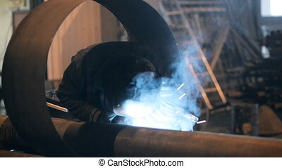 Welding Engineer weld for the creation of pipesa lot of...