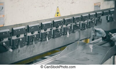 press to bend steel prepared for operation by inserting the...