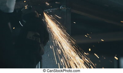 dynamic video Industrial engineer working on cutting a metal and steel with compound Metal Angle Grinder Machine