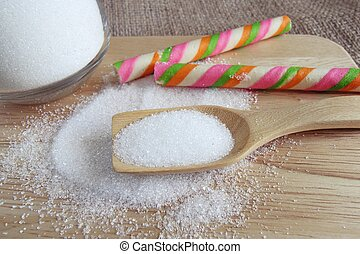 white sugar in wooden spoon - sweet white sugar in wooden...