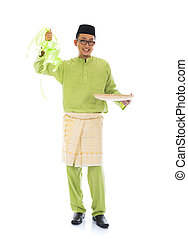 traditional malay male with ketupat