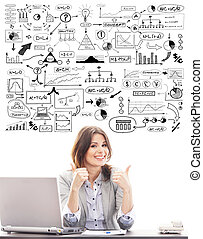 Beautiful business woman with conceptual schemes and...