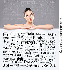 Beautiful girl with a banner of world's different languages...