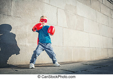 Superhero - Little boy with boxing gloves