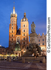 St Mary Basilica and Adam Mickiewicz Monument at Night in...