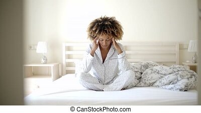 Depressed Woman On The Bed - Depressed african-american...
