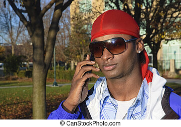 young African American man on a cell phone - closeup of a...