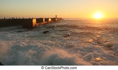 Atlantic ocean surf on the pier during a stunning sunset