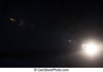 lens flare of modern car - driving car in night, modern...