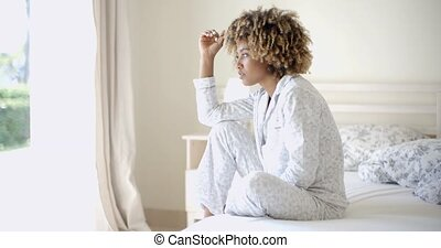 Lonely Sad Woman Deep In Thoughts - Woman sitting on bed...