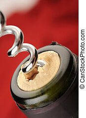 Cork Screw - Extreme close-up of wine bottle and cork screw