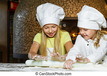Making the dough for pizza is fun - little chefs playing...