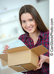 Woman holding a cardboard box