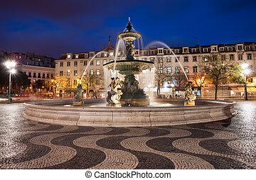 Rossio Square at Night in Lisbon - Fountain on Rossio Square...