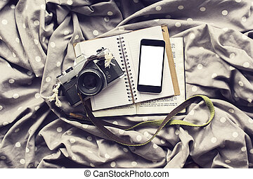 Blank white smartphone screen with old style camera and...