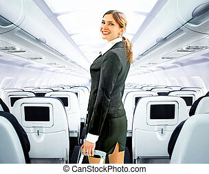 flight attendant - beautiful flight attendant on board of...