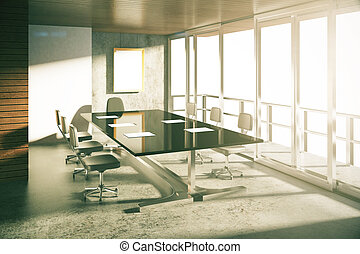Loft style conference room with concrete floor at sunrise
