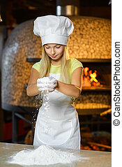 Funny happy chef girl cooking at restaurant kitchen and...