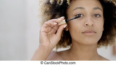 Woman Face With Mascara Brush - Close up of african american...