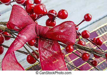 Christmas Red ribbon on holly leaves