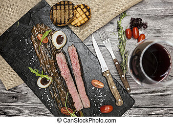 Ribeye steak from marble beef meat with vegetables and...