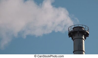 Industrial chimney flue gas detail with white smoke, blue...