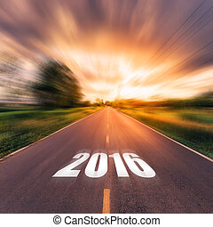 country road and field with beautiful sunset vintage. Forward to the New Year 2016.
