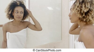 Woman Viewing Herself In The Mirror - Woman viewing herself...