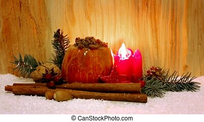 Baked apple with Christmas decoration on a wooden background...