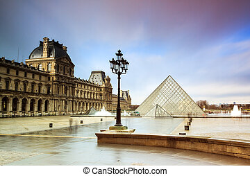 Rainy Louvre - Beautiful view of the Louvre museum in Paris,...