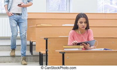 Smiling young girl watches her classmate go past her - Nice...
