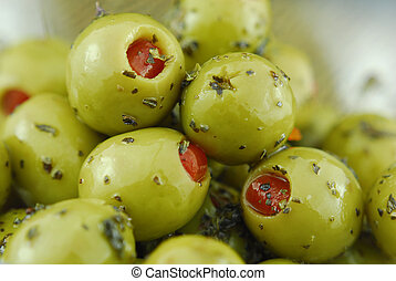 green olives stuffed with pimento spiced with basil and oil