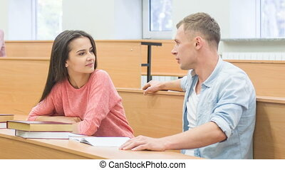 Female student chatting with her classmate - Pleasant talk...