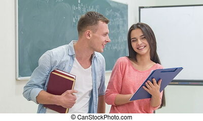 Two students are communicating in the classroom - Discussing...