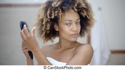 Woman Fixing Hair In The Morning - Beautiful black woman...