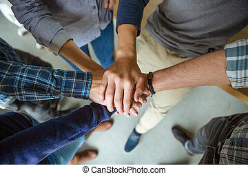 People joining hands together - Top view of people joining...
