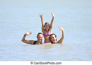 Girls - Three nice girls are waving from the water...