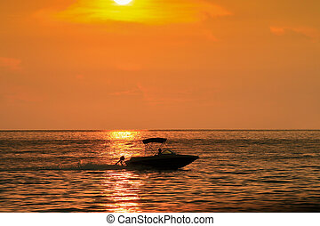 Silhouette of a speed boat in sea