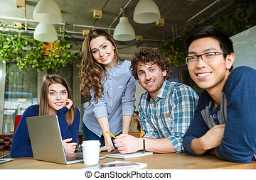 Group of modern businesspeople having a meeting in conference room