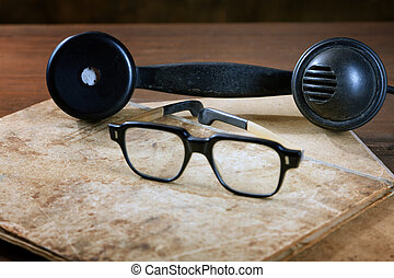 Old writing-books and glasses on a wooden table
