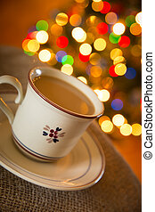 christmas coffee - Hot coffee in a cup with Christmas tree...