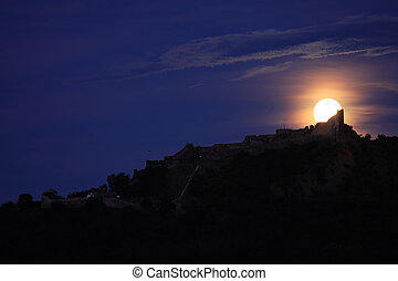 Full moon - A full moon is above a castle