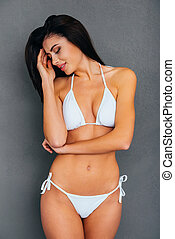 Sensual beauty. Attractive young woman in white bikini...
