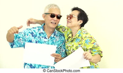 Asian couple holding white sign - Video Happy Asian senior...