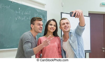 Three classmates are making funny selfies - Hilarious...