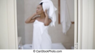 Young Woman Wrapped In Towels - Portrait of a young woman...