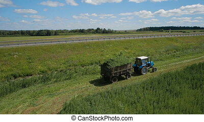 Aerial footage of a tractor in field russia