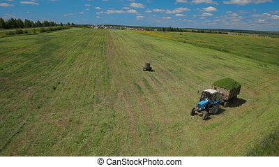 Aerial footage of a tractor in field russia - Aerial footage...